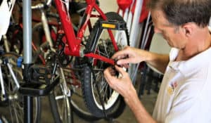 Freewheels Houston volunteers make sure bikes are safe and in good running order before they are distributed to refugees.