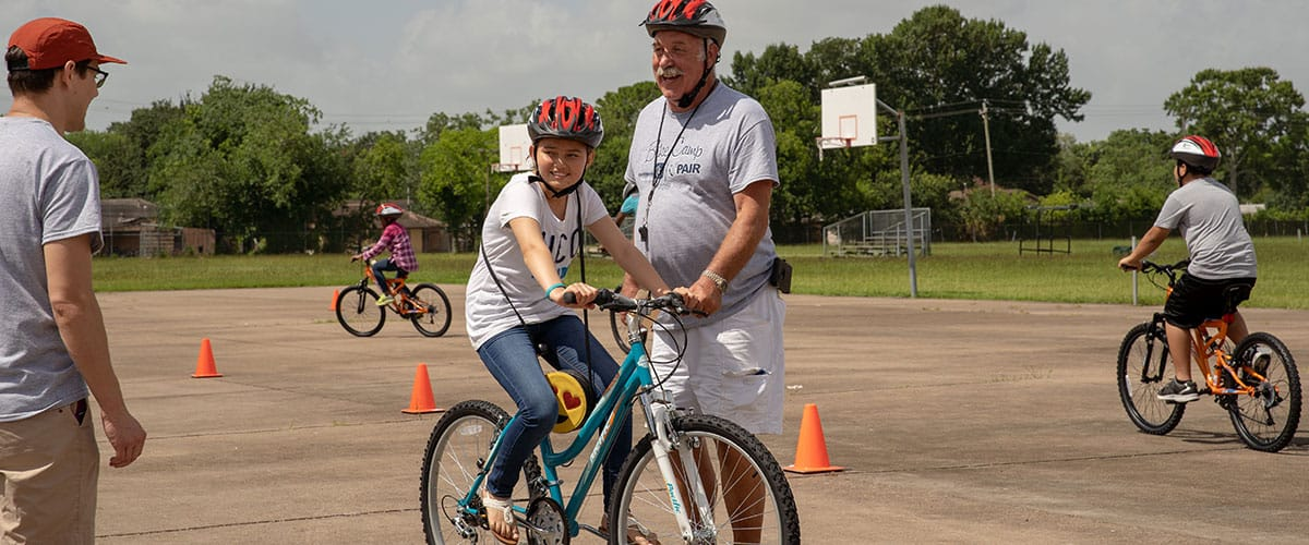 For many young refugee women, the Freewheels Houston Bike Camp was their first experience riding a bike.