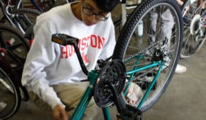 Getting a bike ready to ride is a welcome challenge for volunteers who represent the welcoming Houston community.